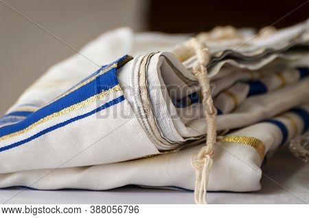 Folded Tallit With Tzitzit Knot. It Is A Traditional Jewish Prayer Shawl - Fringed Garment Worn By R