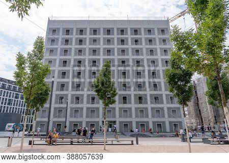 Stuttgart, Germany - Aug 1, 2020 - Plaza In Front Of Public Library Building With Few People With Ma