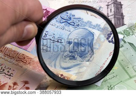 Libyan Dinar In A Magnifying Glass A Business Background