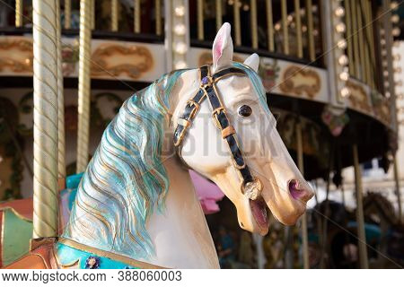 Colorful Wooden Horse Of A Children Circus Carousel