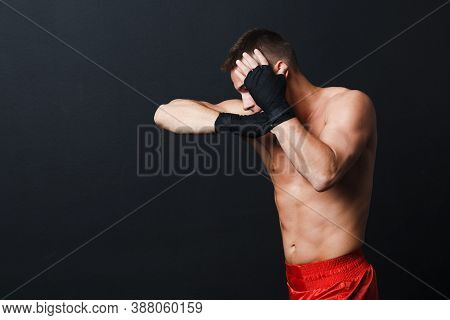 Sportsman Muay Thai Man Boxer Stance Ad Elbow Punch At Black Background