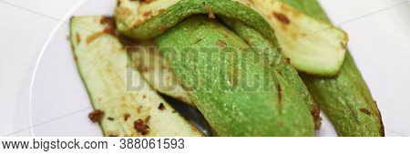 Close-up Of Baked Delicious Zucchini. Fresh Juicy Vegetable Served On White Plate. Tasty Vegs For He