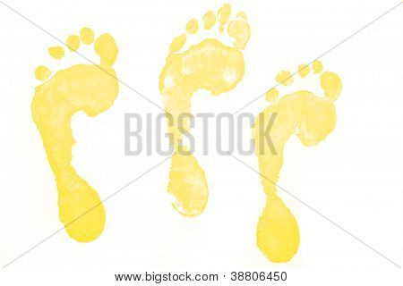 Three yellow footprints against a white background