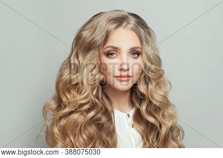 Attractive Blonde Woman With Long Healthy Curly Hair