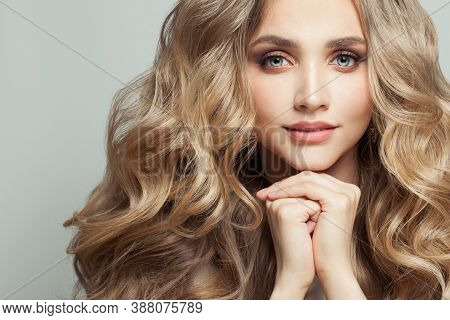 Smiling Blonde Woman With Long Healthy Curly Hair
