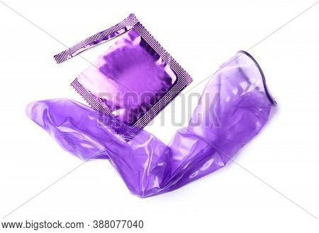 Unrolled Violet Condom And Package On White Background. Safe Sex