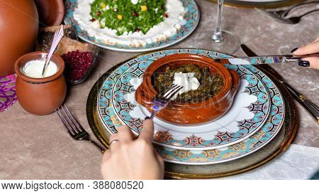 Woman Eating Dolma, Azerbaijani Meal Top View