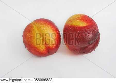 Two Fresh Sweet Nectarines Covered With Water Droplets