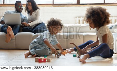 Happy Family Enjoying Free Weekend Leisure Time At Home.