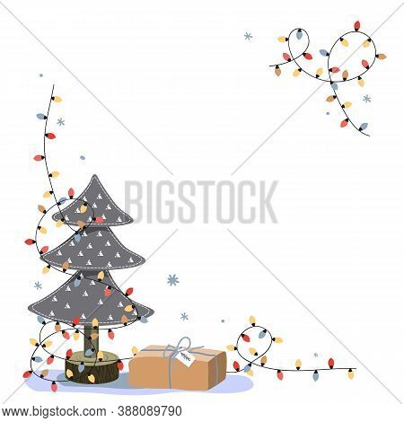 Christmas Corner Composition With Place For Text. Miniature Felt Fir Tree, Gift Box, And Bright Ligh