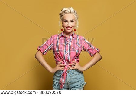 Pin-up Young Woman Smiling On Yellow Background