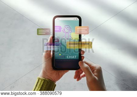 Livechat Technology Concept. Customer Using Mobile Phone To Make Conversation With An Artificial Int