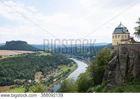 The Beautiful Elbe River Flows In A Mountainous Area With Rich Vegetation And A Small Teahouse On A