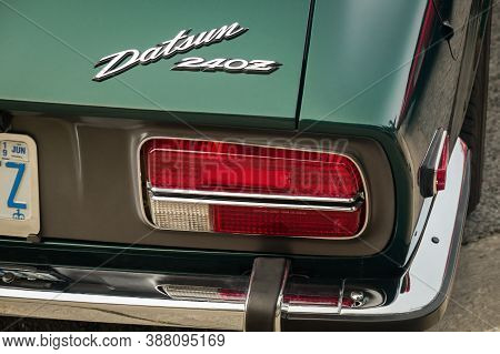 Toronto, Canada - 08 18 2018: Datsun Logo On The Trunk Of 1971 Datsun 240z Coupe Oldtimer Sports Car