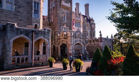 Toronto, Canada - 10 09 2018: Casa Loma Lit With Sunset Run Rays. Casa Loma Is A Gothic Revival Cast