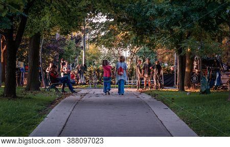 Toronto, Canada - 10 09 2018: Sunset Scene - People Having Fun In Spadina Park In Midtown Toronto