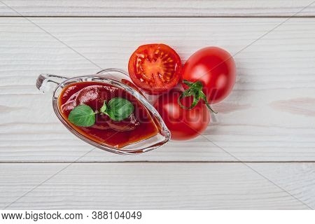 Cherry Tomatoes, And A Glass Sauceboat With Ketchup On A White Background. Seasonings, Tomato Sauce