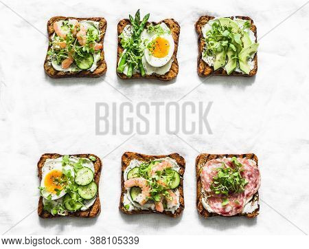 Variety Breakfast, Appetizer, Tapas Bread Sandwiches With Cream Cheese, Egg, Asparagus, Avocado, Cuc