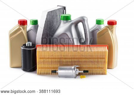 Car Filters And Motor Oil Can Isolated On White. High Quality Photo