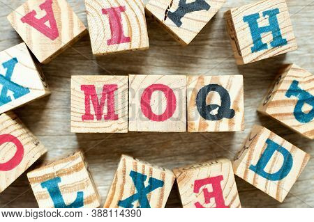 Alphabet Letter Block In Word Moq (abbreviation Of Minimum Order Quantity) With Another On Wood Back
