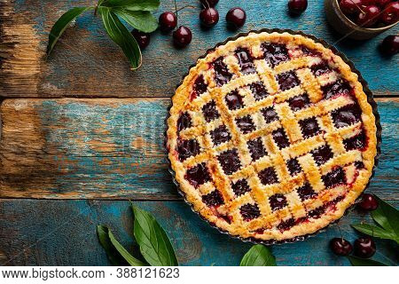 Delicious Homemade Classic Cherry Pie With A Flaky Crust On Blue Rustic Background, Top View