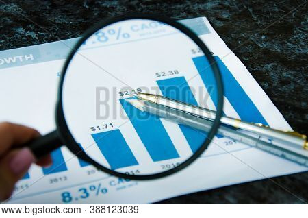 Magnifier Calculator Lies On A Color Chart. Financial Responsibility. High Quality Photo