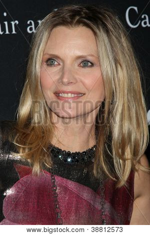 """LOS ANGELES - OCT 26:  Michelle Pfeiffer arrives at """"The Pink Party '12"""" at Hanger 8 on October 26, 2012 in Santa Monica, CA"""