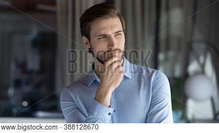 Young Pensive Businessman Thinking Of Professional Challenges.