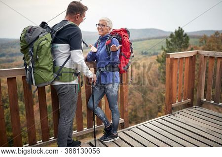 Senior couple trekking in the woods; Active retirment concept
