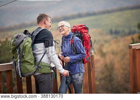 Senior enjoying the view aftre hiking; Active retirment lifestyle