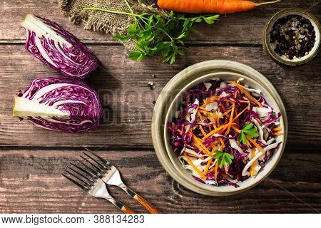 Salad Cole Slaw. Autumn Cabbage Salad In A Bowl On A Rustic Wooden Table. Flat Lay Top View.