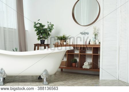 Modern Stylish Bathroom Without Anyone. Front View Of White Modern Bath In Contemporary Apartment Wi