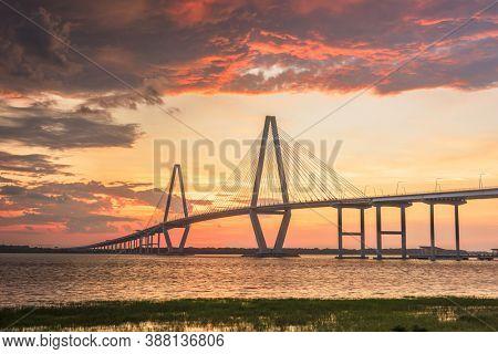 Charleston, South Carolina, USA at Arthur Ravenel Jr. Bridge at dusk.