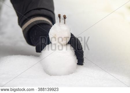A Small Snowman Made Of Snow, A Nose Made Of Icicles. Baby Snowman For Baby Baby. Warming, The Arriv
