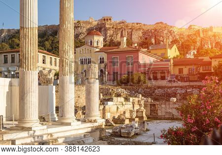 Hadrian`s Library Overlooking Famous Acropolis At Sunset, Athens, Greece. Sunny View Of Ancient Gree