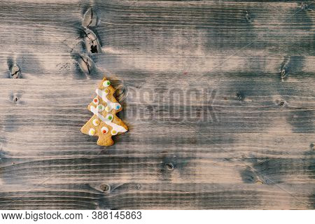 Christmas Homemade Gingerbread Cookies In Form Of Christmas Tree On Old Wooden Background With Space