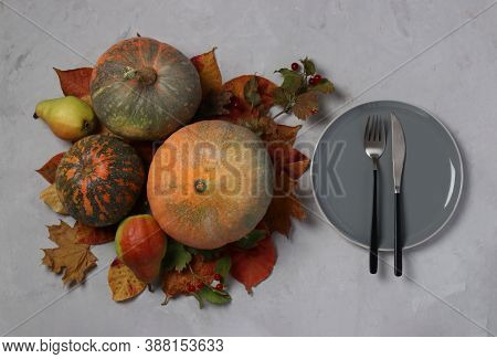 Table Setting On Thanksgiving Day Decorated Pumpkin, Viburnum, Pears And Colorful Leaves On Grey. Vi