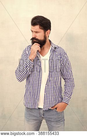 Attractiveness Concept. Well Groomed Guy. Brutal Handsome Hipster Man Grey Wall Background. Bearded
