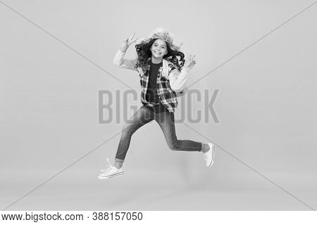 Captured In Motion. Winter Season Concept. Kid Girl Wear Hat With Ear Flaps. Winter Vacations. Winte