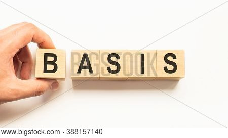 Word Basis. Wooden Small Cubes With Letters Isolated On White Background With Copy Space Available.