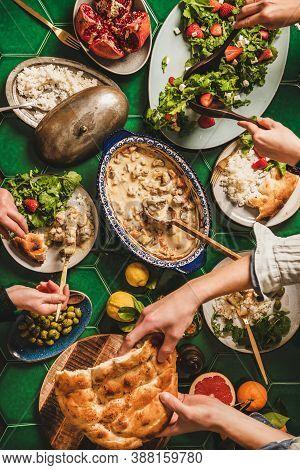 Flat-lay Of People Having Turkish Style Dinner For Ramazan Supper