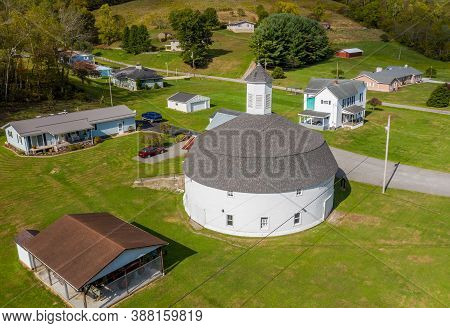 Mannington Wv - 3 October 2020: Aerial View Of Well Preserved White Wooden Round Barn With Cupola In