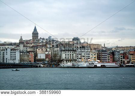 Galata Tower, On Its Hill, In Karakoy And Beyoglu District, Taken During A Cloudy Winter Afternoon,