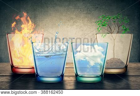 Four Elements Of The Nature In Glasses Isolated On Studio Gray Background. Natural Symbol Concept.