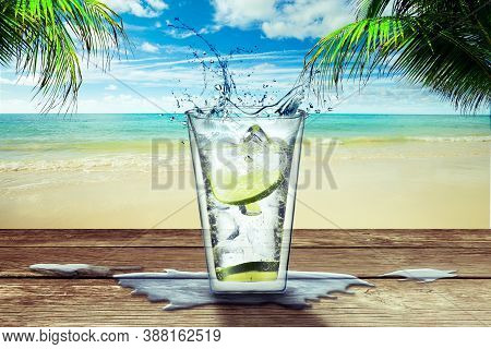 One Glass With Lemonade On A Wooden Bar Table On A Tropical Beach As Background, Coconut Trees Aroun