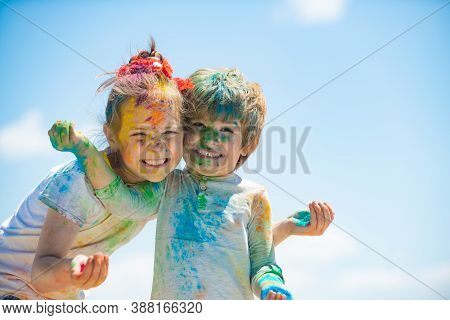 Happy Childhood. Kids Playing Colours With Smeared Face. Holi Festival Of Colors. Child Girls And Bo