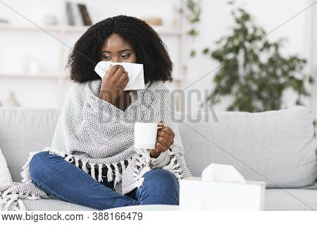 Fever, Cold, Flu Symptoms And Folk Medicine. Sick Ill Black Woman Covered In Blanket Blowing Her Run