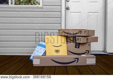 Calgary, Alberta, Canada. Oct 4, 2020. Amazon Deliver Boxes And Envelopes At A Home Entrance Just De