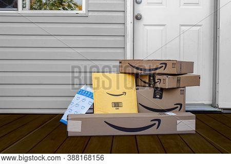 Calgary, Alberta, Canada. Oct 4, 2020. Amazon Deliver Boxes And Envelopes At A Home Entrance Just De