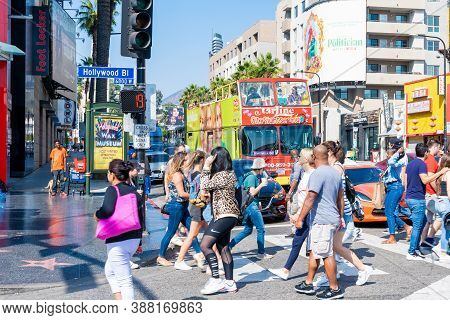 Hollywood, California - October 09 2019: People Crowd Busy Pedestrian Crosswalk And Traffic Intersec
